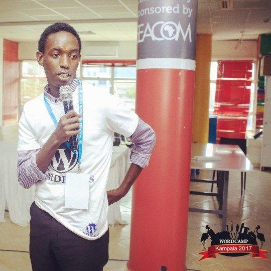 Benjamin Kavubu holding a mic