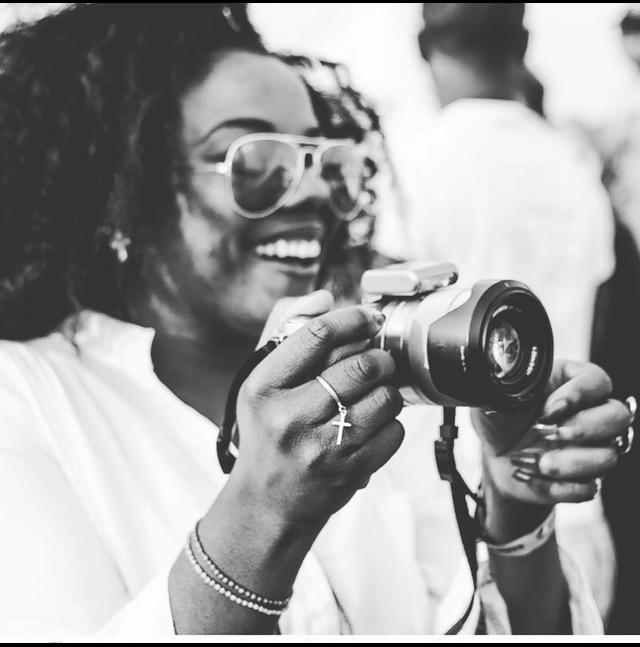 Linda Mulenga Nsunge holding a camera